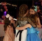 Daddy Daughter Dance sisters hug
