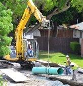 Installing utilities underground.